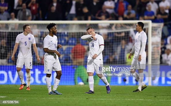 Raheem Sterling and Wayne Rooney look dejected after the 2nd Spanish goal during the international friendly match between Spain and England at the...