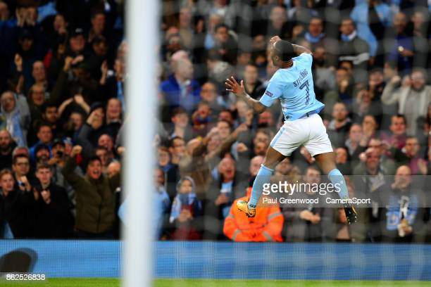 Raheem Sterling celebrates scoring his side's first goal to make the score 10 during the UEFA Champions League group F match between Manchester City...