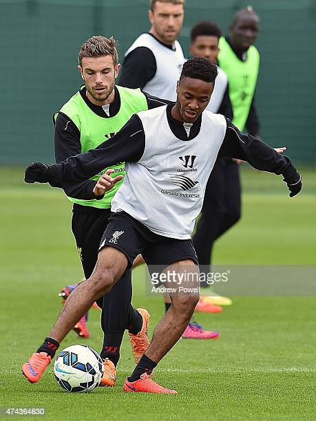 Raheem Sterling competes with Jordan Henderson of Liverpool during a training session at Melwood Training Ground on May 22 2015 in Liverpool England