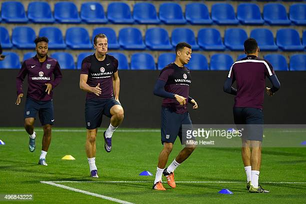 Raheem Sterling Harry Kane and Dele Alli of England warm up during an England training session at the Estadio Jose Rico Perez on November 12 2015 in...