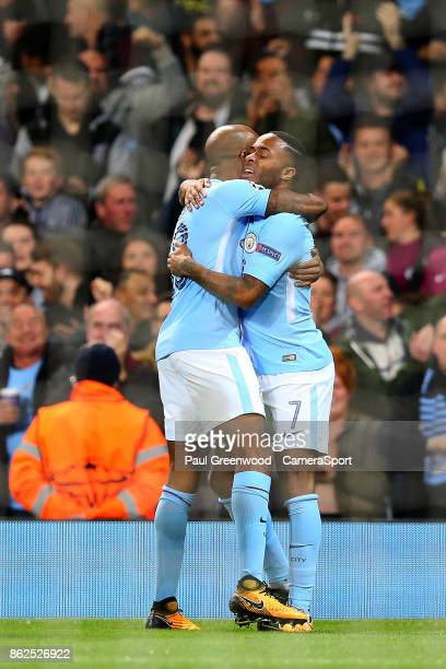 Raheem Sterling is congratulated by Fabian Delph as he celebrates scoring his side's first goal to make the score 10 during the UEFA Champions League...
