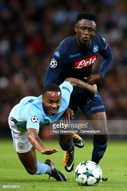 Raheem Sterling is tackled by Amadou Diawara during the UEFA Champions League group F match between Manchester City and SSC Napoli at Etihad Stadium...