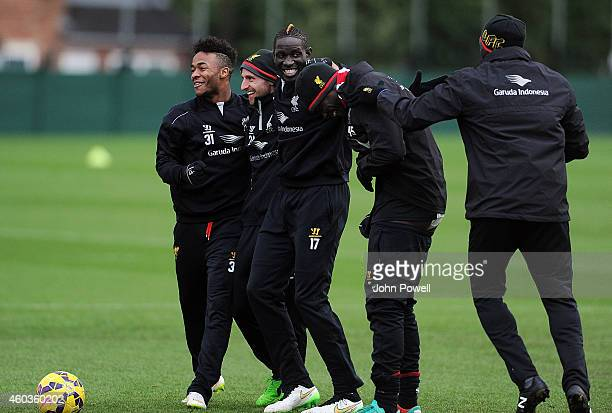 Raheem Sterling Joe Allen Mario Balotelli Mamadou Sakho and Kolo Toure of Liverpool during a training session at Melwood Training Ground on December...