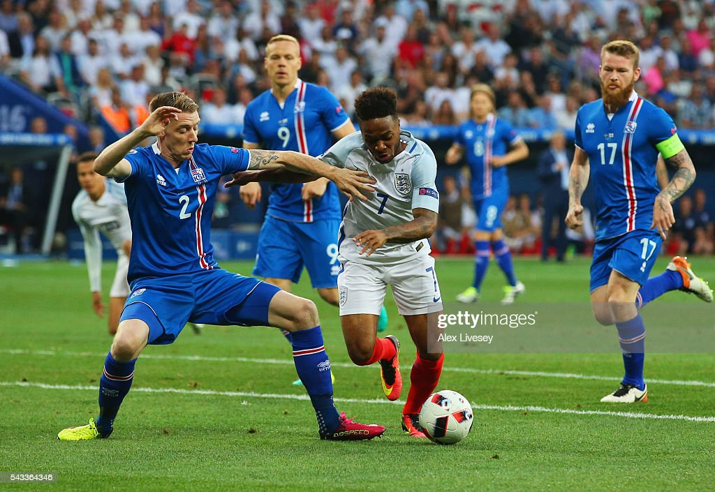 <a gi-track='captionPersonalityLinkClicked' href=/galleries/search?phrase=Raheem+Sterling&family=editorial&specificpeople=6489439 ng-click='$event.stopPropagation()'>Raheem Sterling</a> of England and Birkir Saevarsson of Iceland compete for the ball during the UEFA EURO 2016 round of 16 match between England and Iceland at Allianz Riviera Stadium on June 27, 2016 in Nice, France.