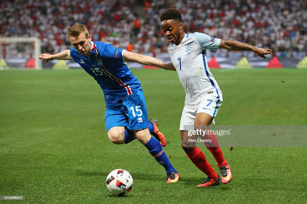 Raheem Sterling of England and Jon Dadi Bodvarsson of Iceland compete for the ball during the UEFA EURO 2016 round of 16 match between England and Iceland at Allianz Riviera Stadium on June 27, 2016 in Nice, France.