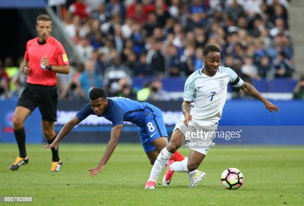Raheem Sterling of England and Thomas Lemar of France during the international friendly match between France and England at Stade de France on June...