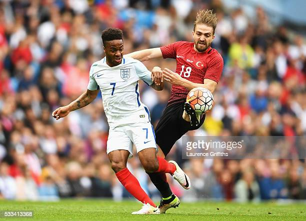 Raheem Sterling of England battles for the ball with Caner Erkin of Turkey during the International Friendly match between England and Turkey at...