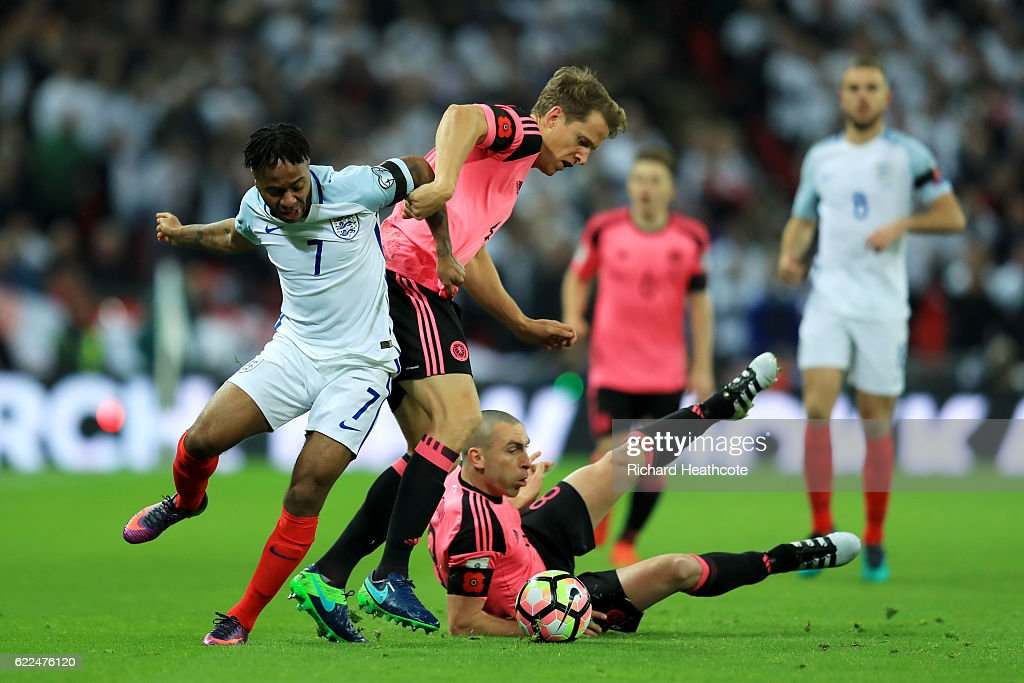 Raheem Sterling of England battles with Scott Brown (8) and Christophe Berra of Scotland (4) during the FIFA 2018 World Cup qualifying match between England and Scotland at Wembley Stadium on November 11, 2016 in London, England.