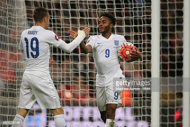 Raheem Sterling of England celebrates after scoring a goal to make it 20 with Jamie Vardy during the UEFA Euro 2016 Qualifier match between England...