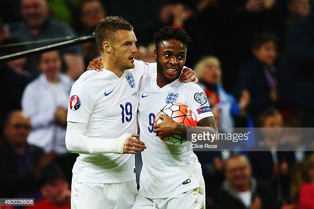 Raheem Sterling of England celebrates with Jamie Vardy as he scores their second goal during the UEFA EURO 2016 Group E qualifying match between...
