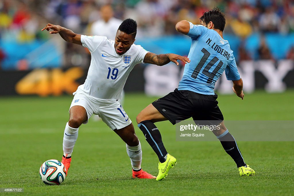 Raheem Sterling of England controls the ball against Nicolas Lodeiro of Uruguay during the 2014 FIFA World Cup Brazil Group D match between Uruguay...