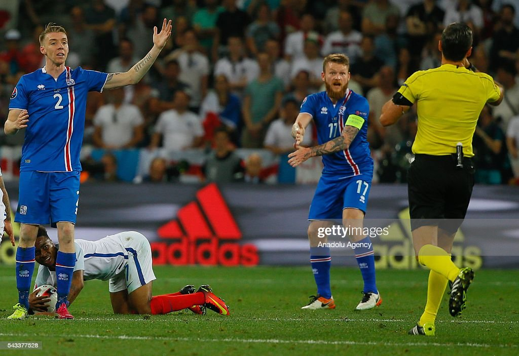 Raheem Sterling (7) of England in action against Birkir Sævarsson (2) and Aron Gunnarsson (17) of Iceland during the UEFA Euro 2016 Round of 16 football match between Iceland and England at Stade de Nice in Nice, France on June 27, 2016.