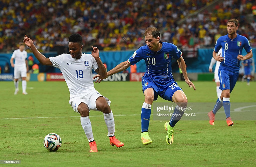<a gi-track='captionPersonalityLinkClicked' href=/galleries/search?phrase=Raheem+Sterling&family=editorial&specificpeople=6489439 ng-click='$event.stopPropagation()'>Raheem Sterling</a> of England in action with <a gi-track='captionPersonalityLinkClicked' href=/galleries/search?phrase=Gabriel+Paletta&family=editorial&specificpeople=747556 ng-click='$event.stopPropagation()'>Gabriel Paletta</a> of Italy during the 2014 FIFA World Cup Brazil Group D match between England and Italy at Arena Amazonia on June 14, 2014 in Manaus, Brazil.