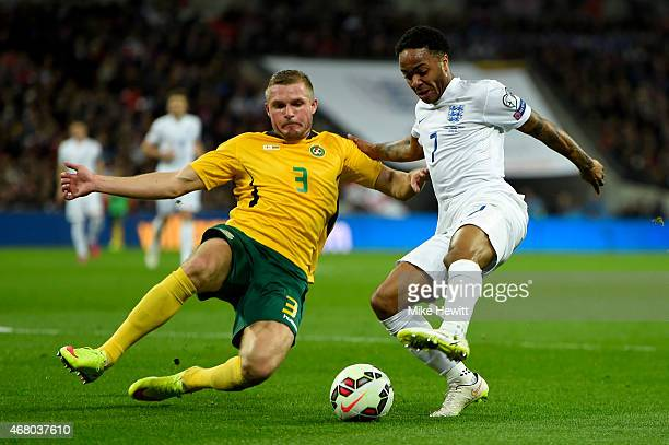 Raheem Sterling of England is challenged by Georgas Freidgeimas of Lithuania during the EURO 2016 Qualifier match between England and Lithuania at...
