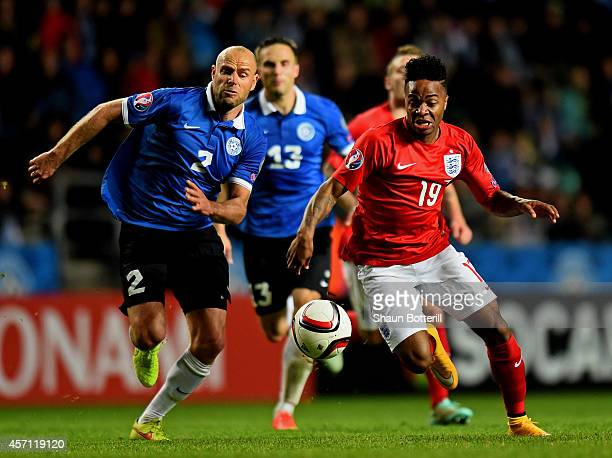 Raheem Sterling of England is challenged by Joal Lindpere of Estonia during the EURO 2016 Qualifier match between Estonia and England at A Le Coq...