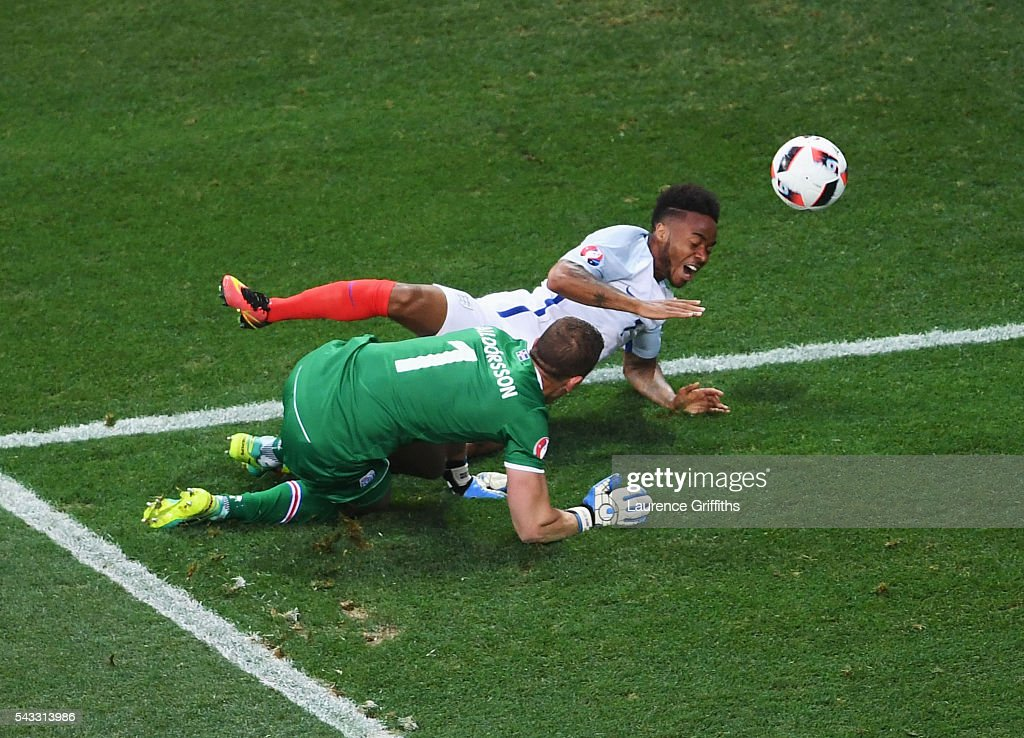 <a gi-track='captionPersonalityLinkClicked' href=/galleries/search?phrase=Raheem+Sterling&family=editorial&specificpeople=6489439 ng-click='$event.stopPropagation()'>Raheem Sterling</a> of England is fouled in the penalty aera by Hannes Halldorsson of Iceland to win a penalty during the UEFA EURO 2016 round of 16 match between England and Iceland at Allianz Riviera Stadium on June 27, 2016 in Nice, France.