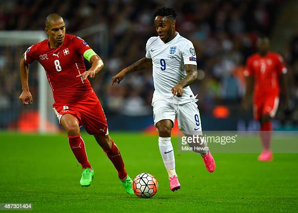 Raheem Sterling of England is marshalled by Gokhan Inler of Switzerland during the UEFA EURO 2016 Group E qualifying match between England and...