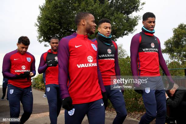 Raheem Sterling of England Jesse Lingard of England and Marcus Rashford of England walk out prior to a England Training Session at the Tottenham...