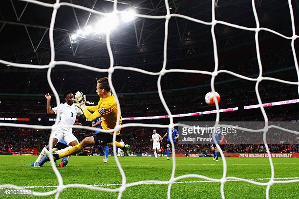 Raheem Sterling of England shoots past Mihkel Aksalu of Estonia as he scores their second goal during the UEFA EURO 2016 Group E qualifying match...