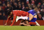 Raheem Sterling of Liverpool and John Terry of Chelsea get tangled up during the Capital One Cup SemiFinal First Leg between Liverpool and Chelsea at...