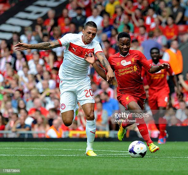 Raheem Sterling of Liverpool and Jose Holebas of Olympiacos compete during the Steven Gerrard Testimonial Match between Liverpool and Olympiacos at...