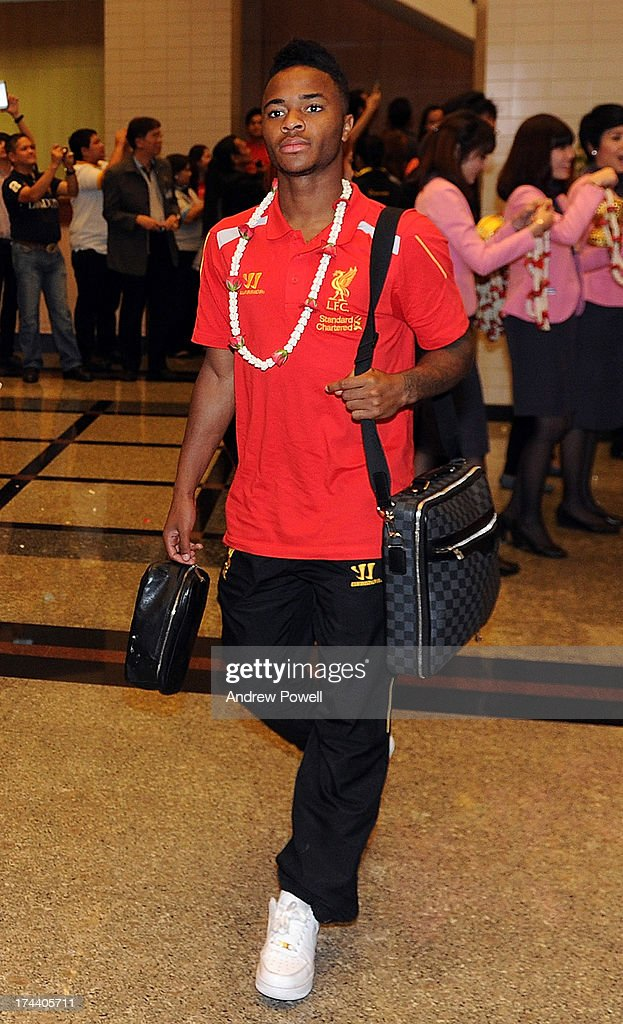 <a gi-track='captionPersonalityLinkClicked' href=/galleries/search?phrase=Raheem+Sterling&family=editorial&specificpeople=6489439 ng-click='$event.stopPropagation()'>Raheem Sterling</a> of Liverpool arrives in Bangkok for a stop on the club's Pre-Season tour on July 25, 2013 in Bangkok, Thailand.