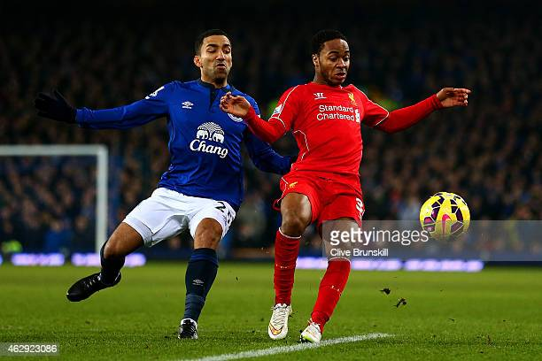 Raheem Sterling of Liverpool battles for the ball with Aaron Lennon of Everton during the Barclays Premier League match between Everton and Liverpool...