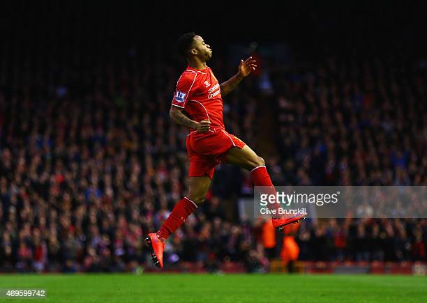 Raheem Sterling of Liverpool celebrates as he scores their first goal during the Barclays Premier League match between Liverpool and Newcastle United...