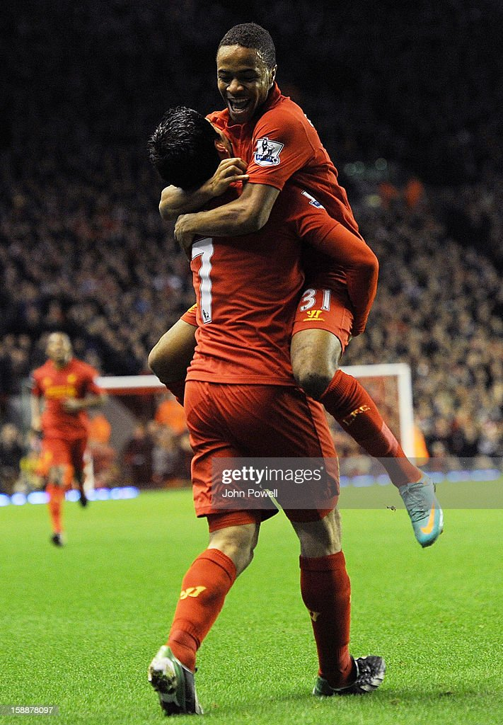 Raheem Sterling of Liverpool celebrates his goal with Luis Suarez to make it 1-0 during the Barclays Premier League match between Liverpool and Sunderland at Anfield on January 2, 2013 in Liverpool, England.