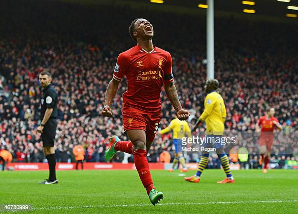 Raheem Sterling of Liverpool celebrates scoring the fifth goal during the Barclays Premier League match between Liverpool and Arsenal at Anfield on...