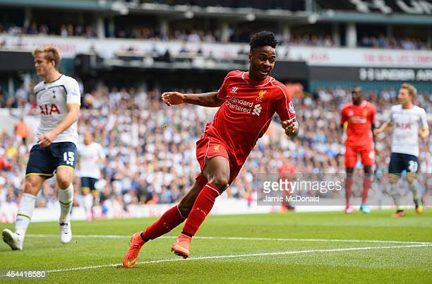 Raheem Sterling of Liverpool celebrates scoring the opening goal during the Barclays Premier League match between Tottenham Hotspur and Liverpool at...