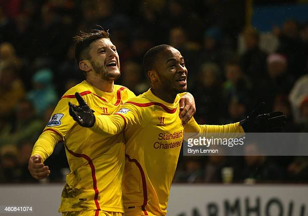 Raheem Sterling of Liverpool celebrates scoring the opening goal with Adam Lallana during the Barclays Premier League match between Burnley and...