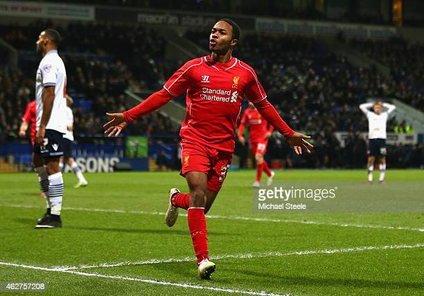 Raheem Sterling of Liverpool celebrates scoring their first goal during the FA Cup Fourth round replay between Bolton Wanderers and Liverpool at...