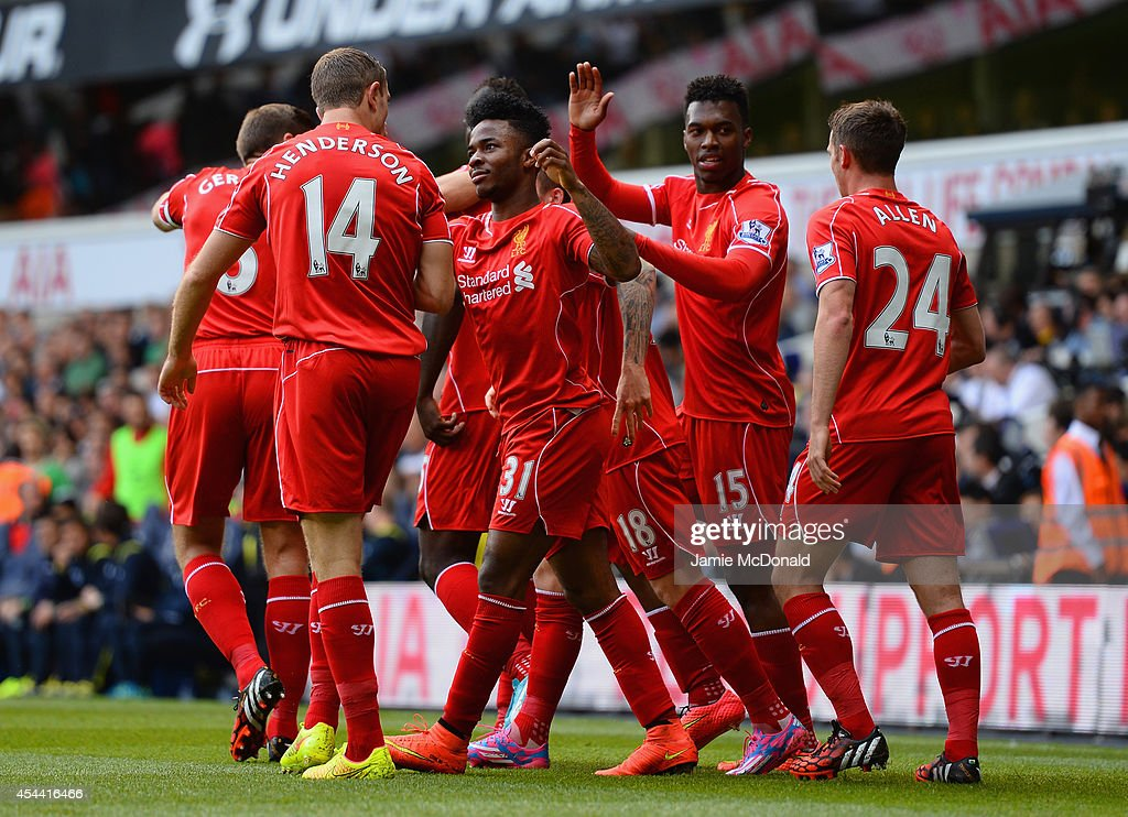 Raheem Sterling of Liverpool celebrates with team mates after scoring the first goal during the Barclays Premier League match between Tottenham Hotspur and Liverpool at White Hart Lane on August 31, 2014 in London, England.
