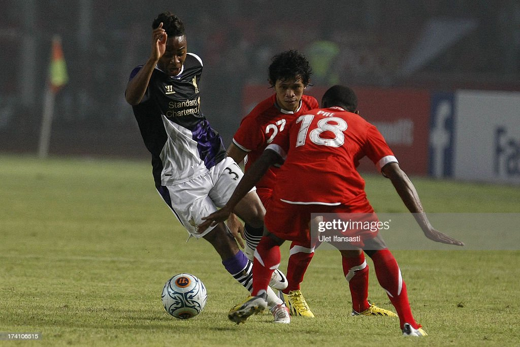 Raheem Sterling of Liverpool competes for the ball with Yustinus Pae of Indonesia XI during the match between the Indonesia XI and Liverpool FC on July 20, 2013 in Jakarta, Indonesia.