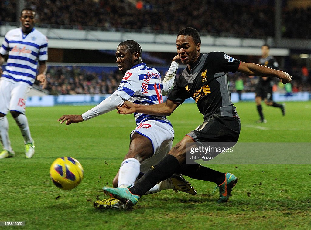 Raheem Sterling of Liverpool competes Shaun Wright-Phillips of Queens Park Rangers during the Barclays Premier League match between Queens Park Rangers and Liverpool at Loftus Road on December 30, 2012 in London, England.
