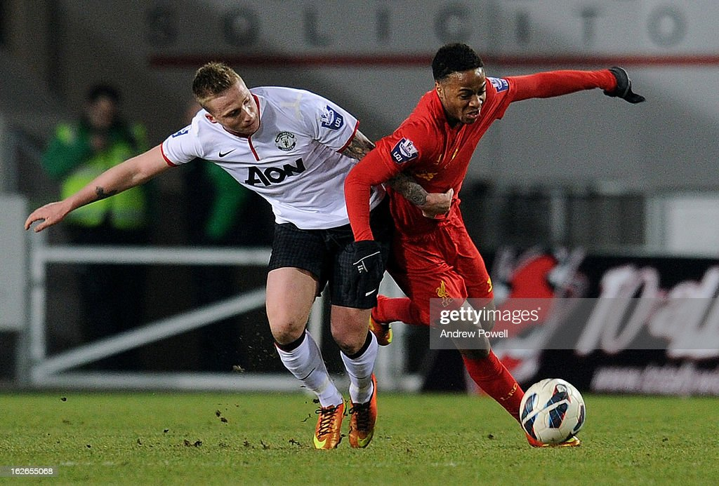 Raheem Sterling of Liverpool competes with Alex Buttner of Manchester United Reservesduring the Barclays Premier Reserve League match between Liverpool Reserves and Manchester United at Langtree Park on February 25, 2013 in St Helens, England.