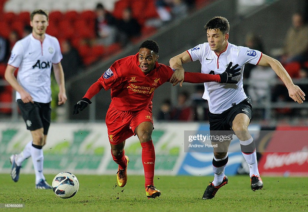 Raheem Sterling of Liverpool competes with Frederic Veseli of Manchester United Reserves during the Barclays Premier Reserve League match between Liverpool Reserves and Manchester United at Langtree Park on February 25, 2013 in St Helens, England.