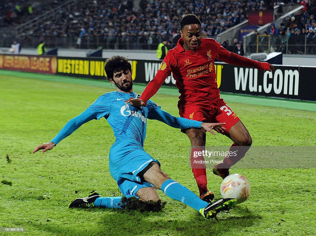 <a gi-track='captionPersonalityLinkClicked' href=/galleries/search?phrase=Raheem+Sterling&family=editorial&specificpeople=6489439 ng-click='$event.stopPropagation()'>Raheem Sterling</a> of Liverpool competes with Luis Neto of FC Zenit St Petersburg during the UEFA Europa League round of 32 first leg match between FC Zenit St Petersburg and Liverpool on February 14, 2013 in Saint Petersburg, Russia.