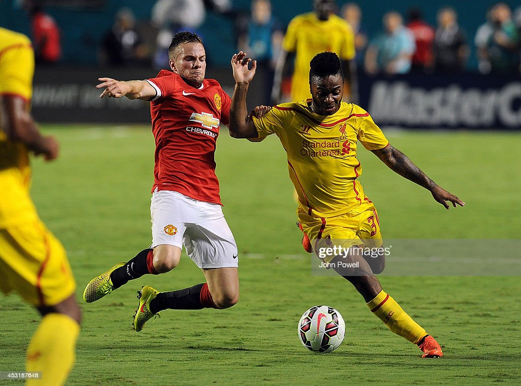 Raheem Sterling of Liverpool competes with Tom Cleverley of Manchester Untied during the International Champions Cup 2014 final match between Liverpool FC and Manchester United at Sun Life Stadium on August 4, 2014 in Miami Gardens, Florida.
