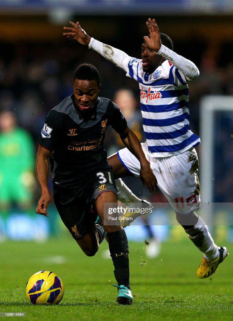 Raheem Sterling of Liverpool goes past Shaun Wright-Phillips of QPR during the Barclays Premier League match between Queens Park Rangers and Liverpool at Loftus Road on December 30, 2012 in London, England.