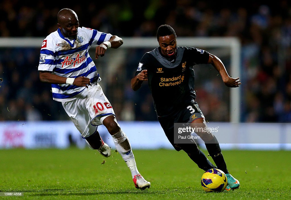 Raheem Sterling of Liverpool goes past Stephane Mbia of QPR during the Barclays Premier League match between Queens Park Rangers and Liverpool at Loftus Road on December 30, 2012 in London, England.