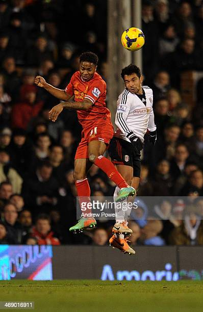 Raheem Sterling of Liverpool goes up with Kieran Richardson of Fulham during the Barclays Premier Leauge match between Fulham and Liverpool at Craven...