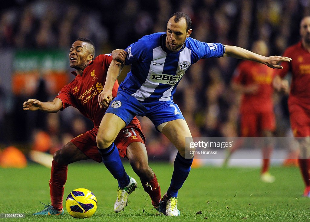 Raheem Sterling of Liverpool in action with Ivan Ramis of Wigan Athletic during the Barclays Premier League match between Liverpool and Wigan...