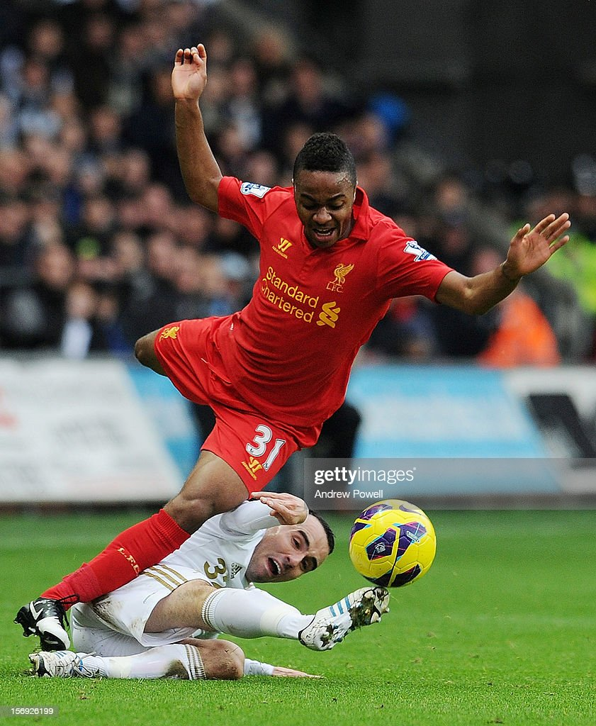 <a gi-track='captionPersonalityLinkClicked' href=/galleries/search?phrase=Raheem+Sterling&family=editorial&specificpeople=6489439 ng-click='$event.stopPropagation()'>Raheem Sterling</a> of Liverpool is brought down by Leon Britton of Swansea City during the Barclays Premier League match between Swansea City and Liverpool at Liberty Stadium on November 25, 2012 in Swansea, Wales.