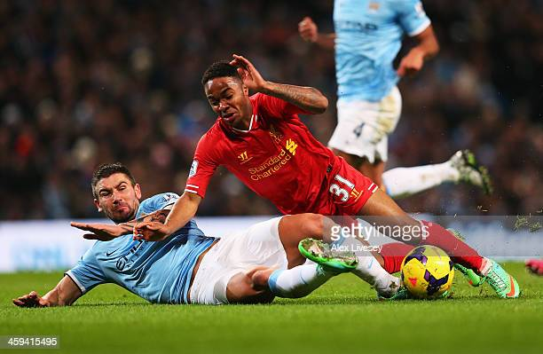 Raheem Sterling of Liverpool is challenged by Aleksandar Kolarov of Manchester City during the Barclays Premier League match between Manchester City...