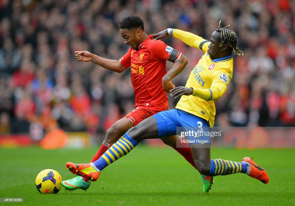 <a gi-track='captionPersonalityLinkClicked' href=/galleries/search?phrase=Raheem+Sterling&family=editorial&specificpeople=6489439 ng-click='$event.stopPropagation()'>Raheem Sterling</a> of Liverpool is challenged by <a gi-track='captionPersonalityLinkClicked' href=/galleries/search?phrase=Bacary+Sagna&family=editorial&specificpeople=745680 ng-click='$event.stopPropagation()'>Bacary Sagna</a> of Arsenal during the Barclays Premier League match between Liverpool and Arsenal at Anfield on February 8, 2014 in Liverpool, England.