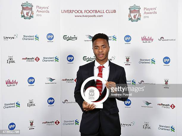 Raheem Sterling of Liverpool poses for a photograph after winning the young player of the year award during the Liverpool Player of the Year Awards...