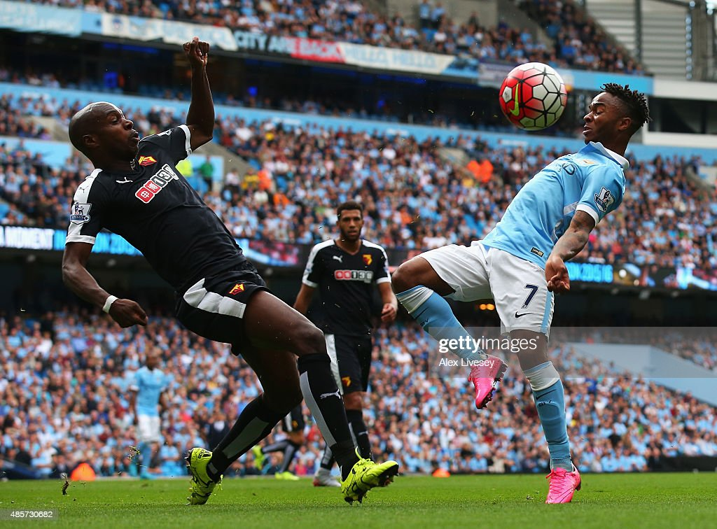 Raheem Sterling of Manchester City and Allan-Romeo Nyom of Watford compete for the ball during the Barclays Premier League match between Manchester City and Watford at Etihad Stadium on August 29, 2015 in Manchester, England.