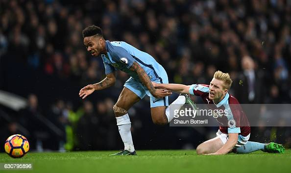 http://media.gettyimages.com/photos/raheem-sterling-of-manchester-city-and-ben-mee-of-burnley-battle-for-picture-id630795896?s=594x594
